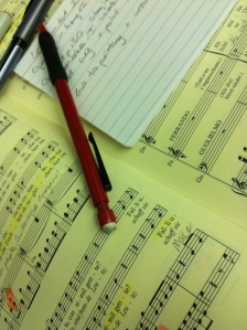 A singer's best tools: score, pencil, cue cards, and memory.